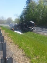 Firefighters work to extinguish a tractor trailer fire Tuesday in Putney.