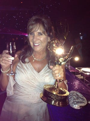 "Metro Detroit native Sally Young holds her Emmy at the awards ceremony in August. ""Modern Family"" has won five consecutive Emmy Awards for best comedy series, tying ""Frasier"" for most awards in a row in that category."