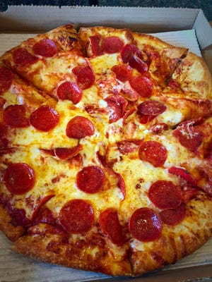A large, original crust pepperoni pizza ($11.74) is served with a three-cheese blend atop a sauce of vine-ripened tomatoes and made-from-scratch dough.