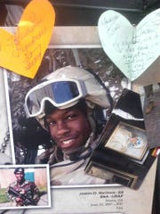 A memorial honors Jason Nathan, Vanderbilt linebacker Nigel Bowden's brother, who was killed in action in Iraq in 2007.