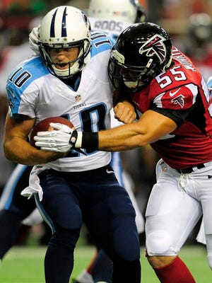 Titans quarterback Jake Locker is sacked by Falcons outside linebacker Paul Worrilow during the first quarter.