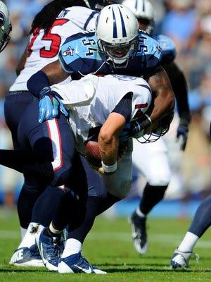 Titans inside linebacker Avery Williamson sacks Texans quarterback Ryan Fitzpatrick during the second quarter.