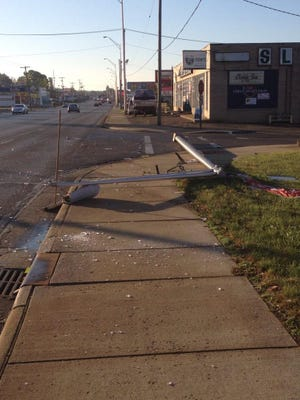 Traffic is flowing normally after a truck hit a pole near Slaters Hardware. Glass is all over the road