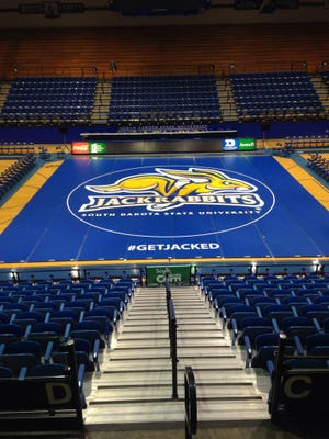 SDSU debuted a new wrestling mat Saturday against Wisconsin.