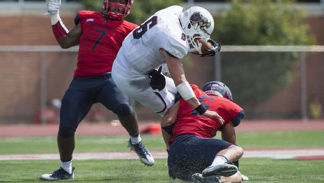 Shippensburg's D.J. Burkey, right, combines for a sack against Gannon's quarterback earlier this season. Burkey led the Raiders in tackles last week, and they will need another solid defensive effort this week versus Lock Haven.