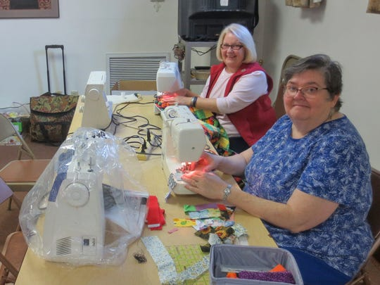 On a recent Wednesday morning, quilters work at sewing machines at Advent Lutheran Church.  The quilters are, from left, Cathy Schneider, Carol Miller, and Lisa Deeter.