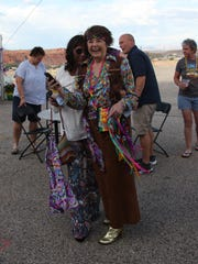 Tamara Walker (left) and Kim Ashton get into the spirit at the 1960s-inspired Equality Celebration in St. George on May 19, 2018.