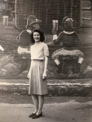 In 1947, Mary McCabe, now 91, is photographed in front of the old Vernors plant on Woodward Ave. in Detroit with the gnomes. McCabe would go there during lunch for a Boston Cooler.