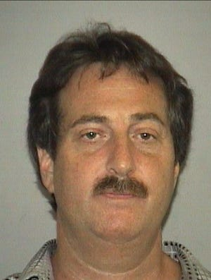 Larry LeGunn is shown in a 2005 photo taken by the Palm Beach County Sheriff's Office in Florida.