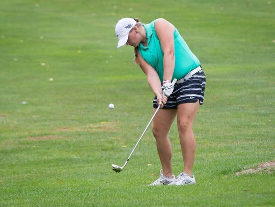 Reece Malapit, a golfer with Yorktown, competes in