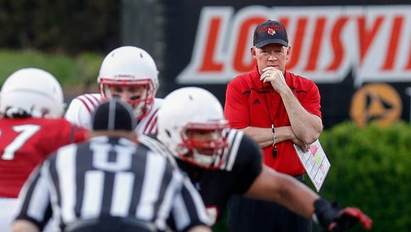 Louisville's Bobby Petrino watches a play develop.