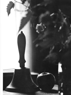 Bell and apple.