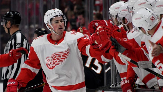 Detroit Red Wings center Dylan Larkin (71) celebrates with teammates after scoring a goal against the Anaheim Ducks in the first period of an NHL hockey game at Honda Center on March 16, 2018.
