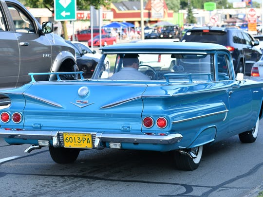 A 1960 El Camino, with little railings in the cargo area,  heads south during the Woodward Dream Cruise on Woodward Avenue in Royal Oak, Mich. on Aug. 19, 2017. 
