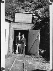 Earl and Ethel Rasmussen posed for a photo at the entrance