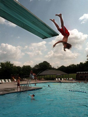A swimmer jumps off the high dive at Dolphin Club in Brentwood in 1998.