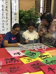 Rutgers professor Fuhua Liu instructs Sylvia Faragalla