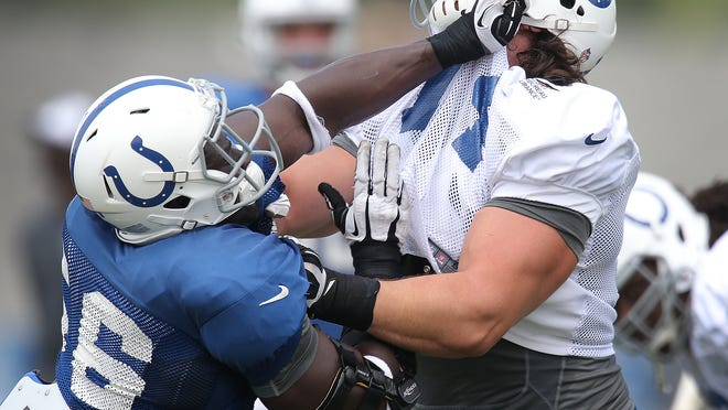 Indianapolis Colts Daniel Adongo,left, spars wit Anthony Castonzo,right, on the third day of Training Camp Saturday July 26, 2014, afternoon at Anderson University. Matt Kryger / The Star