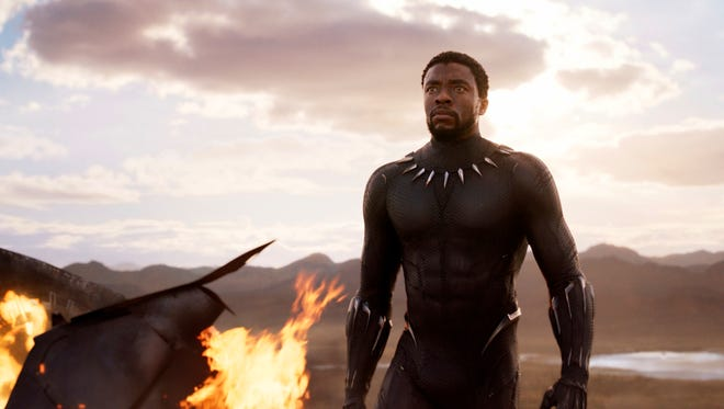 "This image released by Disney and Marvel Studios' shows Chadwick Boseman in a scene from ""Black Panther,"" in theaters on Feb. 16, 2018. (Marvel Studios/Disney via AP) ORG XMIT: CAET868"