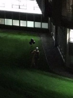 This photo was altered in Photoshop and created as a hoax. It shows an image of a clown standing in the shadows near Wilson Hall.