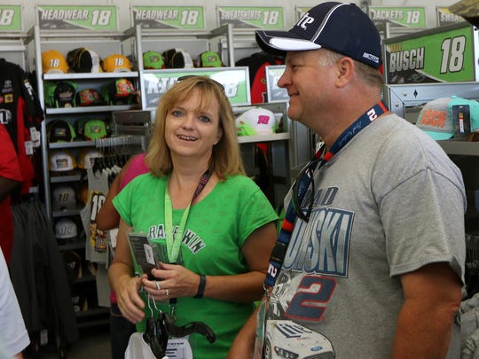 Jennifer Mickle of Maryland, N.Y. and friend Brian Bookhout shop at the Trackside Superstore Sunday at Watkins Glen International.