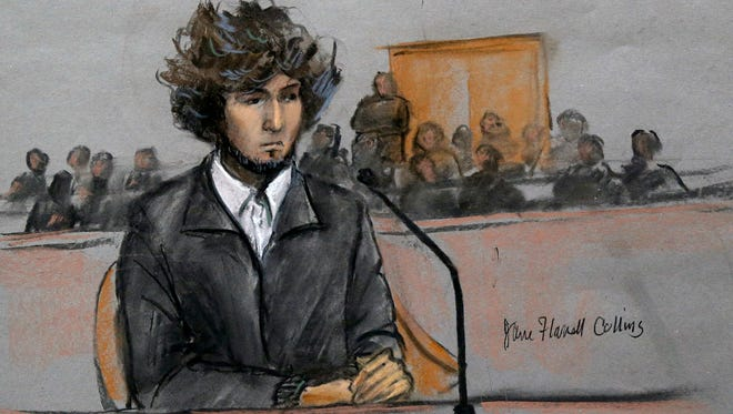 In this courtroom sketch, Boston Marathon bombing suspect Dzhokhar Tsarnaev is depicted sitting in federal court in Boston on Dec. 18, for a final hearing before his trial begins in January.