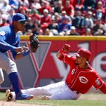 Reds center fielder Billy Hamilton (6) slides safely after stealing second base under Chicago Cubs shortstop Starlin Castro (13).
