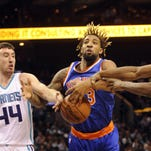 Nov 11, 2015; Charlotte, NC, USA; New York Knicks forward Derrick Williams (23) (center), Charlotte Hornets forward center Frank Kaminsky (44) (left) and guard Kemba Walker (15) (right) go after a loose ball during the first half of the game at Time Warner Cable Arena. Mandatory Credit: Sam Sharpe-USA TODAY Sports
