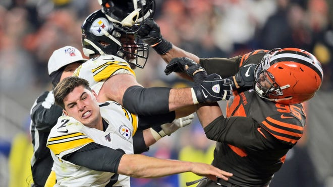 Browns defensive end Myles Garrett hits Steelers quarterback Mason Rudolph with a helmet during a game Nov. 14.