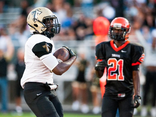 Golden Gate high school's Chauncy Pelissier(11) takes the ball in for a touchdown during a game against Lely high school in Naples, Fla. on Friday, Sept. 9, 2016.