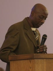Walter Thornton, pastor of the Mount Sinai Baptist Church, reads from scripture during the Martin Luther King Jr. Celebration at Maddox Memorial Church of God In Christ on Sunday evening.