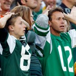 New York Jets fans react after a touchdown catch was called back because the team called a time out before the ball was snapped during the second half Sunday against the Green Bay Packers