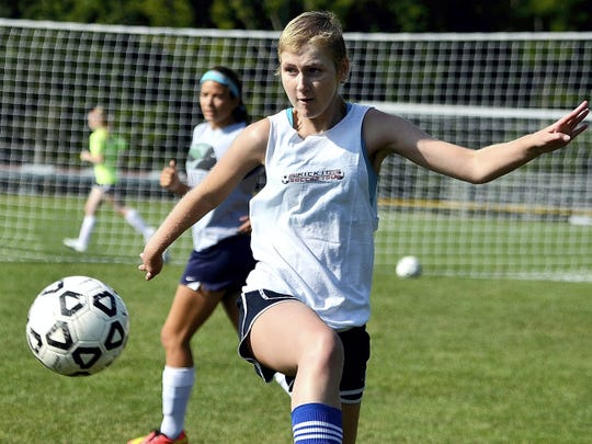 Maddie Hill is shown here at a soccer practice during her senior year at Dover High School.