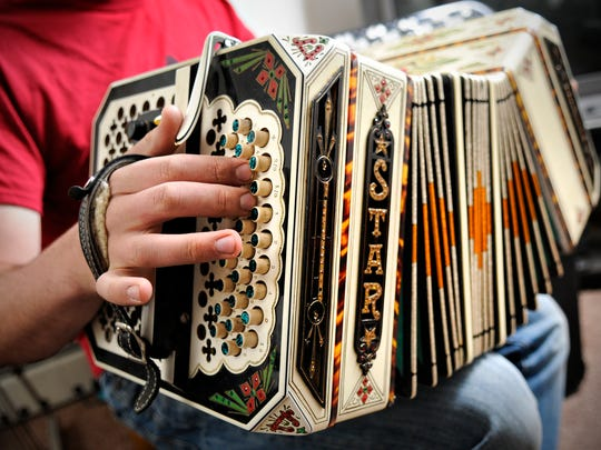 Nathan Neuman plays 10 instruments, including the concertina.