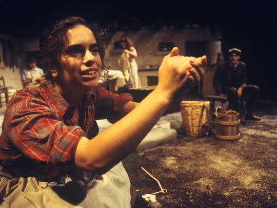 "Shana Cooper acts in a Willamette University production. After graduating in 1999, Cooper built a successful career as a director and even returned to Oregon Shakespeare Festival to direct ""Love's Labor's Lost"" in 2011."