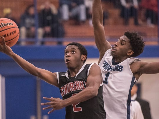 Going up for a basket is Churchill's Trajan Stinson