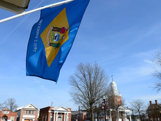 The Delaware State Flag near The Circle in Georgetown on Thursday, Feb. 1, 2018.