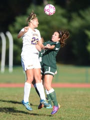 Rhinebeck's Marissa Giamportone goes up for a header against Coleman's Sam O'Donnell during Wednesday's game in Rhinebeck.