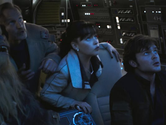 "This image released by Lucasfilm shows Joonas Suotamo, from left, Woody Harrelson, Emilia Clarke and Alden Ehrenreich in a scene from ""Solo: A Star Wars Story."" (Lucasfilm via AP)"