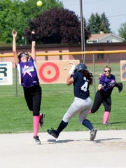 Lakeview's second baseman Hannah Tecumseh goes up for
