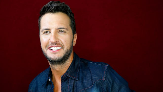 """In this July 14, 2015 photo, Luke Bryan poses for a portrait at Audio Productions in Nashville, Tenn., to promote his latest album, """"Kill the Lights."""""""