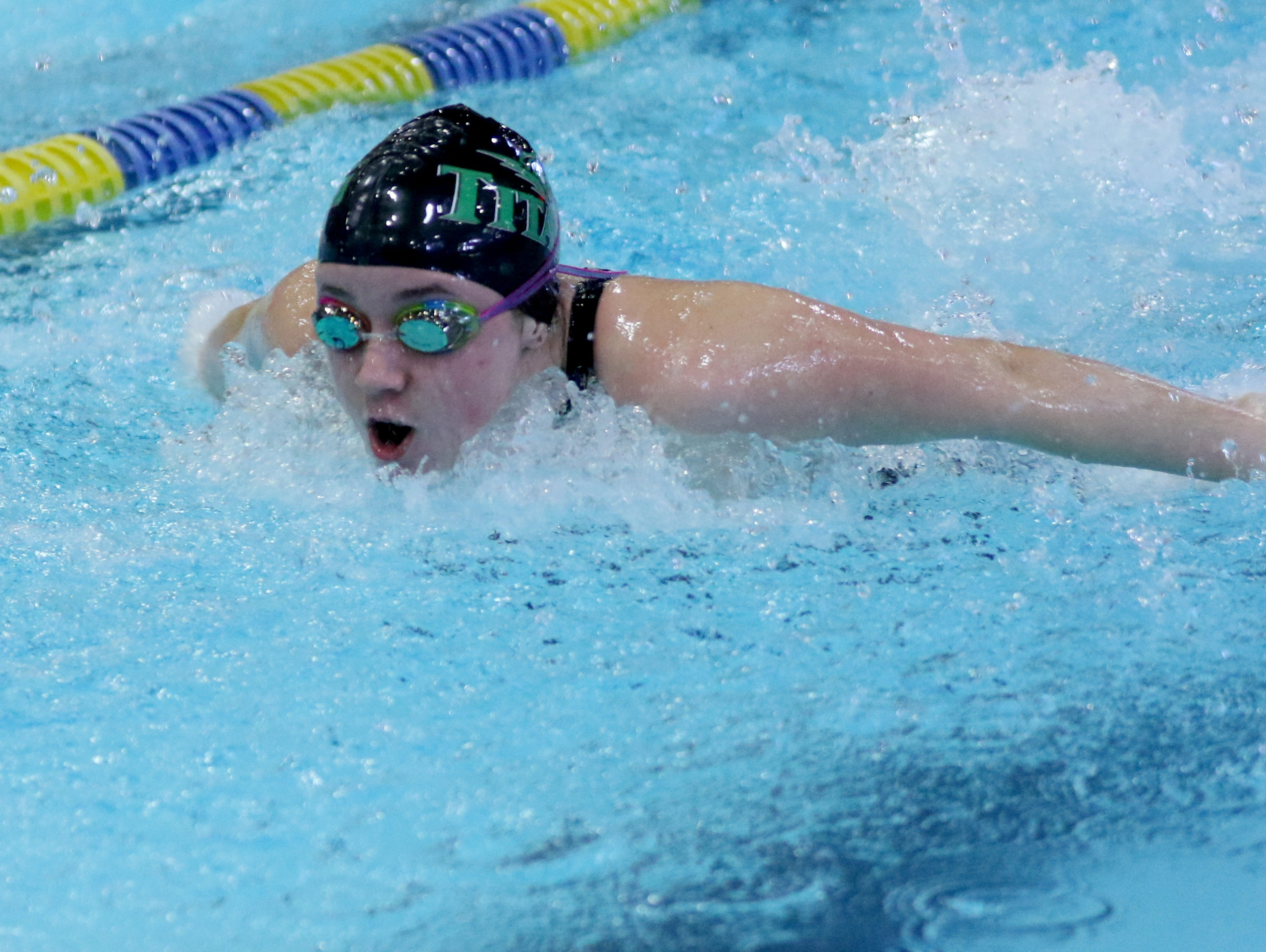 West Salem's Alaina Otterstrom competes in the 100 yard butterfly during the Greater Valley Conference swimming championships at the McMinnville Aquatic Center on Saturday, Feb. 11, 2017.