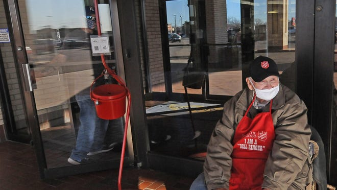 Ray Brown, of Salina, rings the bell for the Salvation Army inside the front lobby of the Central Mall. Brown has been ringing the bell for the Salvation Army for 35 years. He enjoys getting to see the people every year.