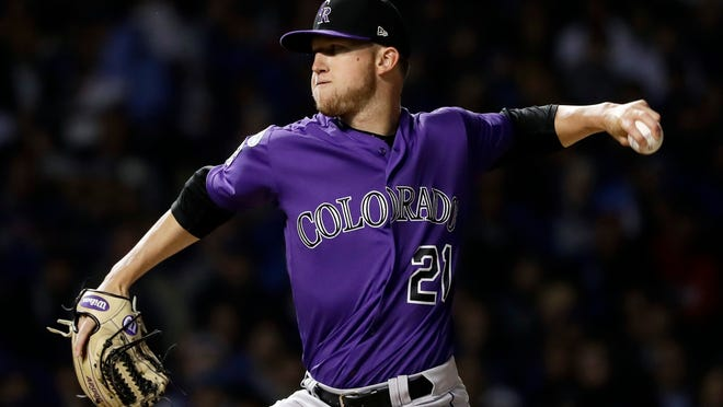 Colorado Rockies starting pitcher Kyle Freeland throws against the Chicago Cubs during the National League wild-card playoff game Tuesday in Chicago. (AP Photo/Nam Y. Huh)