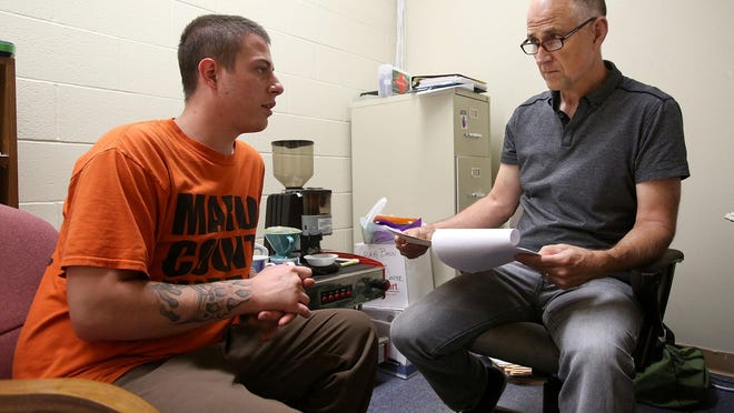 Craig Bazzi, right, transition services manager at Community Action's De Muniz Resource Center, talks with Marion County inmate Brandon Wilhite on Friday, July 10, about searching for a job. The Marion County Reentry Initiative has cut the recidivism rate in half in five years.