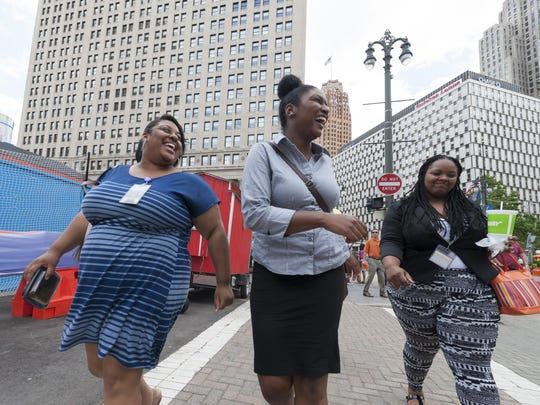 Workers, from left, Jocelyn Sample, Summer Tolbert and Christen Marbury joke around in Cadillac Square after a lunch break from their jobs at the Wayne County Treasurer's Office. Sample is taking part in a program called MSUxDET that embeds students in Detroit.