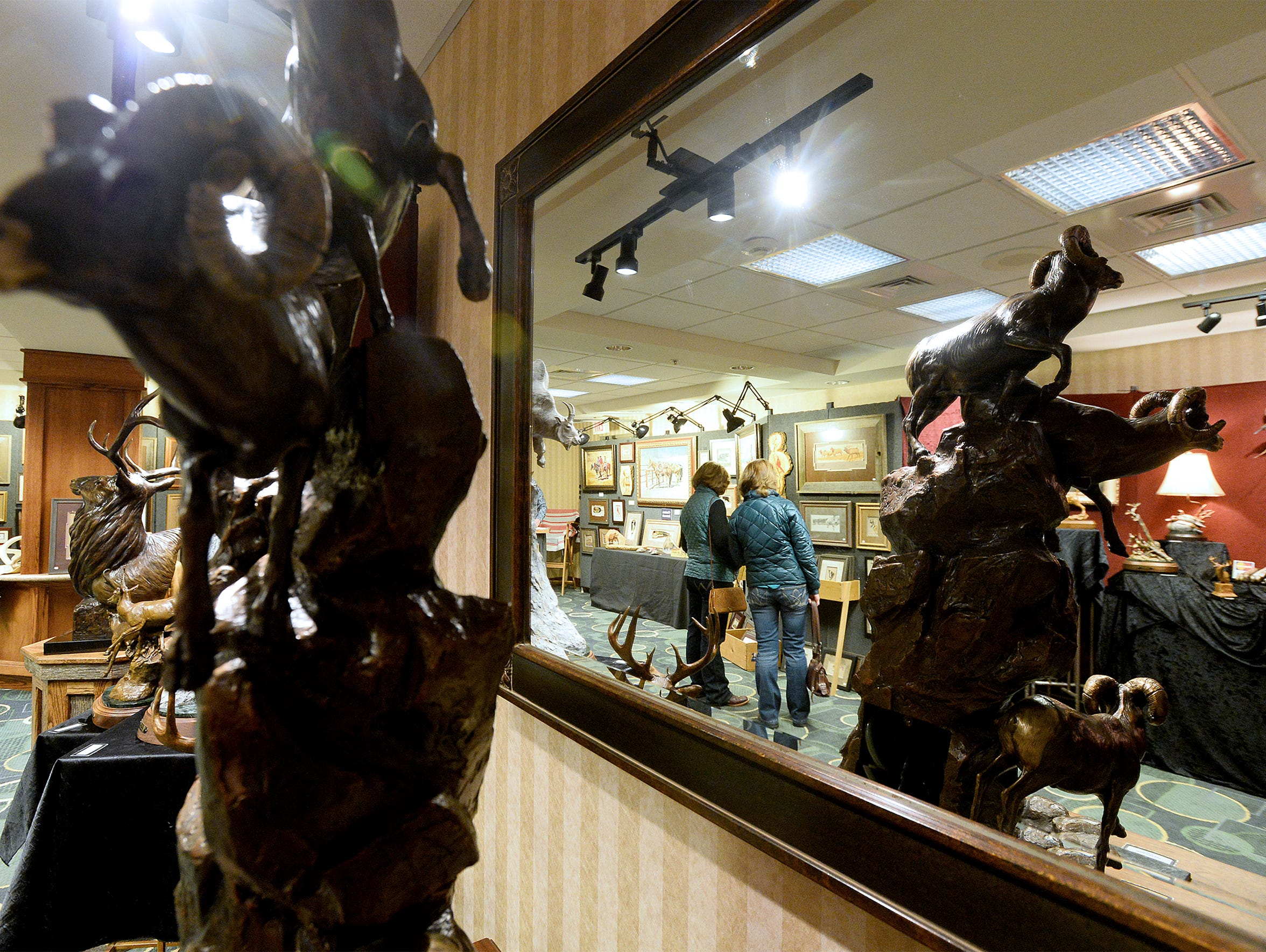 """Ronald Lowery's """"Going to the Sun"""" bronze on display at the Wild Bunch Show in the Hampton Inn."""