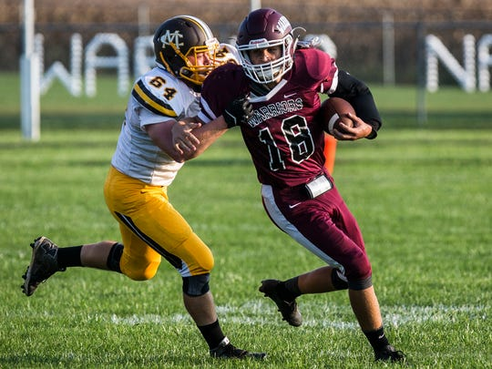 Monroe Central's Terry Kuhns tackles Wes-Del's Camden Townsend during their game at Wes-Del High School Saturday Sept. 24, 2016.