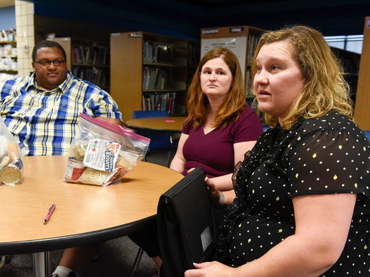 Organizers Marcus Paden, Helen Schommer and Suzanne Friedrich talk about their program to help feed student on weekends and during breaks Friday, Sept. 1 at Discovery School in Waite Park.