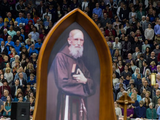 Over 60,000 people from metro Detroit and around the world attend Saturday's ceremony that celebrates the beatification of Father Solanus Casey, Saturday Nov. 18, 2017 at Ford Field in Detroit.